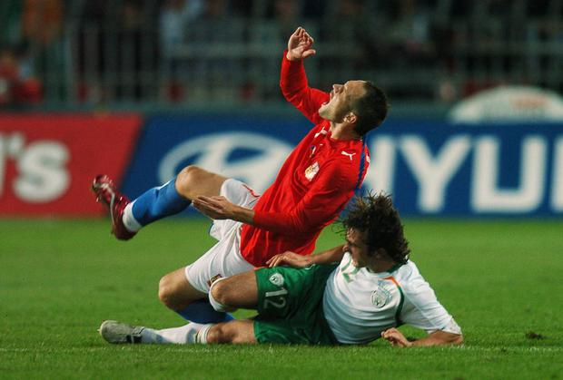 Stephen Hunt, Republic of Ireland, tackles Jan Polak, Czech Republic, for which he was sent off by referee Kyros Vassaras