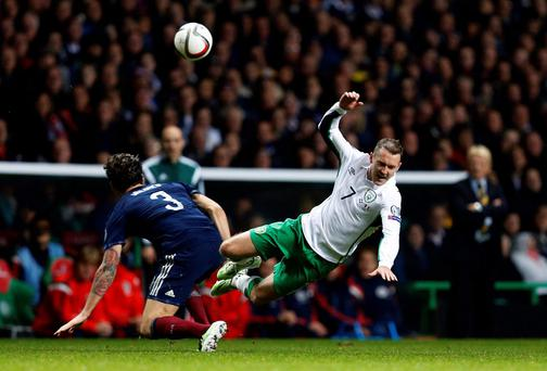 Scotland's Charlie Mulgrew challenges Ireland's Aiden McGeady (R) during their Euro 2016 Group D qualifying soccer match at Celtic Park Stadium