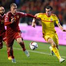 Toby Alderweireld of Belgium and Gareth Bale of Wales battle for the ball during the Group B UEFA European Championship 2016 Qualifier match between Belgium and Wales at King Baudouin Stadium