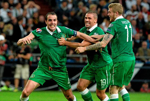 John O'Shea celebrates his equaliser in Gelsenkirchen with Jon Walters and James McClean