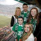 Cody Nolan (10) from Wexford, who suffers with cystic fibrosis, with his mother Michelle, brother Kyle and sisters Victoria, who also has CF, and Kelsey at the Ireland v Poland match at the Aviva stadium in Dublin