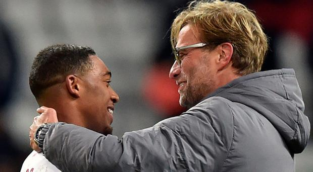 Jordon Ibe is congratulated by Liverpool manager Jurgen Klopp after his goal in last night's Europa League win in Russia