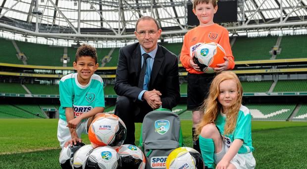 Martin O'Neill was on hand to launch the 2016 SportsDirect.com FAI Summer Soccer Schools programme with Braydon Roche, Benjamin Lynch and Sadhbh McKane (SPORTSFILE)
