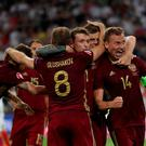 Russia celebrate their late equaliser against England. Photo: PA