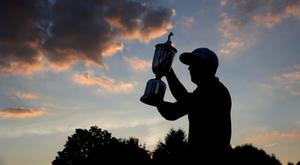 Dustin Johnson with the trophy. Photo: AP