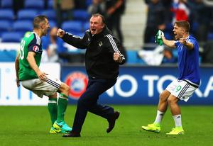 Michael O'Neill celebrates Northern Ireland's second goal against Ukraine Aaron Hughes (left) and Jamie Ward at Euro 2016. Photo: Julian Finney/Getty Images