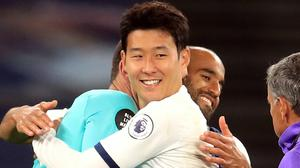 Spurs team-mates Hugo Lloris and Son Heung-min embrace after a clash earlier in the game (Adam Davy/NMC Pool/PA)