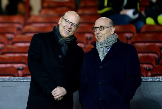 Manchester United joint chairmen Joel Glazer (right) and Avram Glazer (left). The Glazer family have been in charge of the club since 2005 (Martin Rickett/PA)