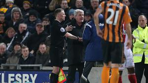 Steve Bruce and Gus Poyet had to be restrained in Tuesday's 'feisty' encounter