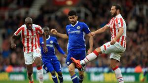 Diego Costa, pictured centre, came in for some rough treatment at Stoke