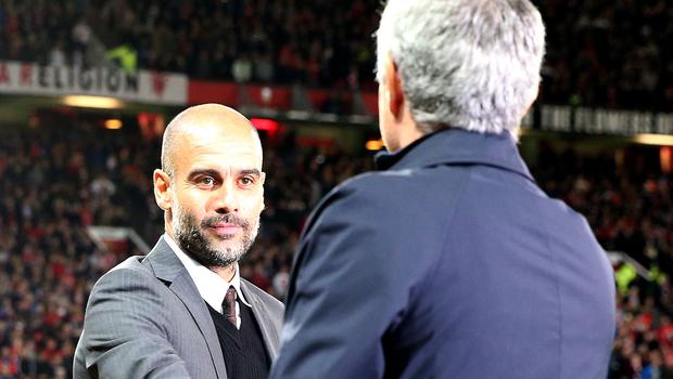 Old rivals Pep Guardiola (left) and Jose Mourinho face each other this weekend (Martin Rickett/PA)