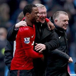 Patrice Evra, left, has once again praised the team spirit at Manchester United
