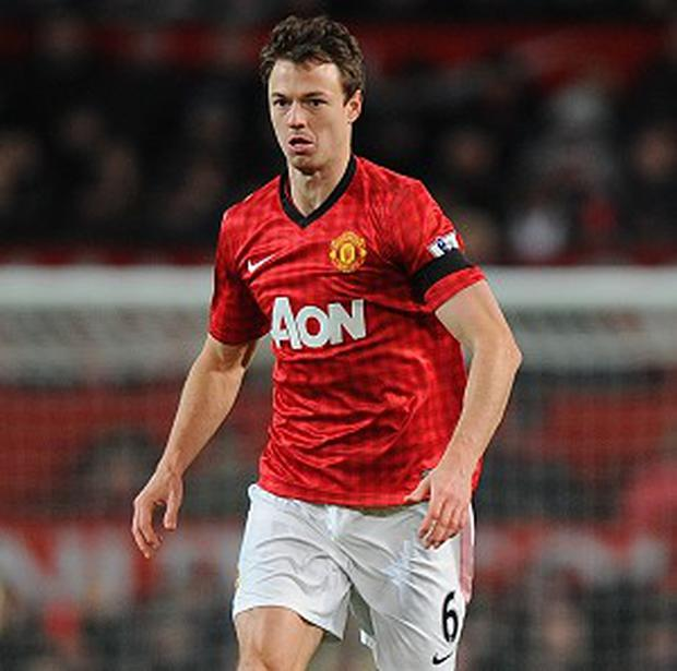 Jonny Evans, pictured, was shocked when he heard of Sir Alex Ferguson's retirement