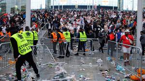 Stewards struggle to deal with fans before the Euro 2020 final at Wembley