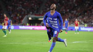 England's Raheem Sterling celebrates scoring against Hungary with a tribute to Steffie Gregg. Photo: Reuters