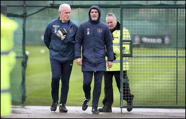 Roy Keane arrives at training with goalkeeping coach Seamus McDonagh