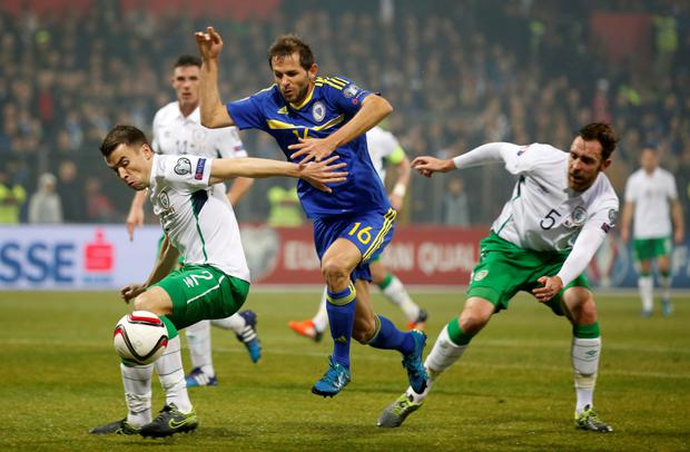 Seamus Coleman keeps Bosnia's Senad Lulic at bay