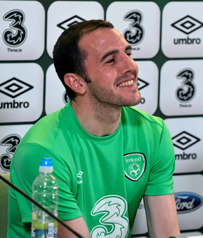 John O'Shea in jovial mood as he answers a question at yesterday's press conference (SPORTSFILE)