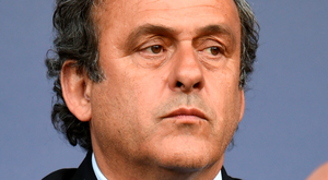 Instead of saying no and blowing up the game, Platini decided to play by the rules that ultimately brought down FIFA. Photo: PA Wire
