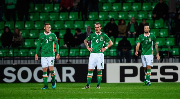 James McCarthy (L) Glenn Whelan (C) and Shane Duffy react after conceding to Moldova during last night's game DAVID MAHER/SPORTSFILE
