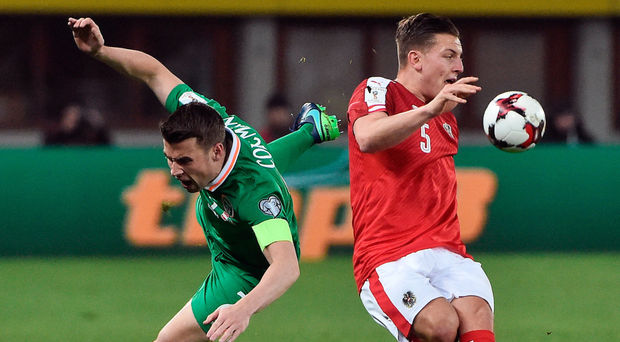 Seamus Coleman tackles Austria's Kevin Wimmer in what was a battling display by the Donegal man yesterday. Photo: Sportsfile