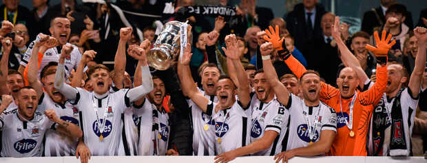 Cup of joy: Dundalk players lift the trophy after yesterday's hard-fought victory over Cork City. Photo: Ramsey Cardy/Sportsfile