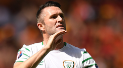 Chin up: Robbie Keane salutes the Irish supporters after Ireland's defeat to Belgium during Euro 2016. Photo: Stephen McCarthy/Sportsfile