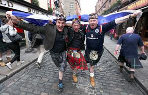 Scottish fans Kes Irving, George Kenpick and Martin Brown show their support for the Saltire in Dublin city centre