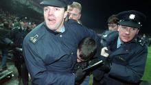 Gardaí restrain a fan during the abandoned game in 1995