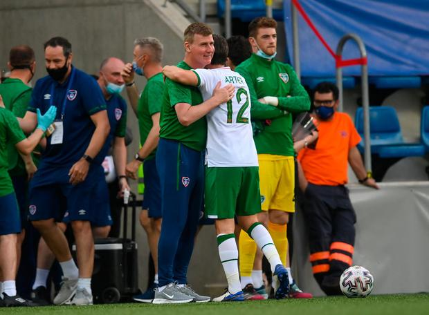 Stephen Kenny embraces Harry Arter after the victory over Andorra