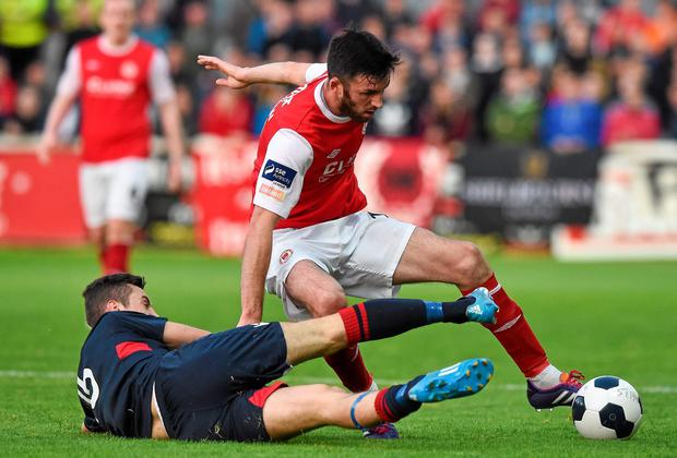 Killian Brennan, St Patrick's Athletic, in action against Dylan Connolly, Shelbourne
