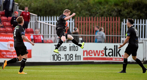 Richie Towell rushes to join in as Daryl Horgan celebrates after scoring Dundalk's second goal