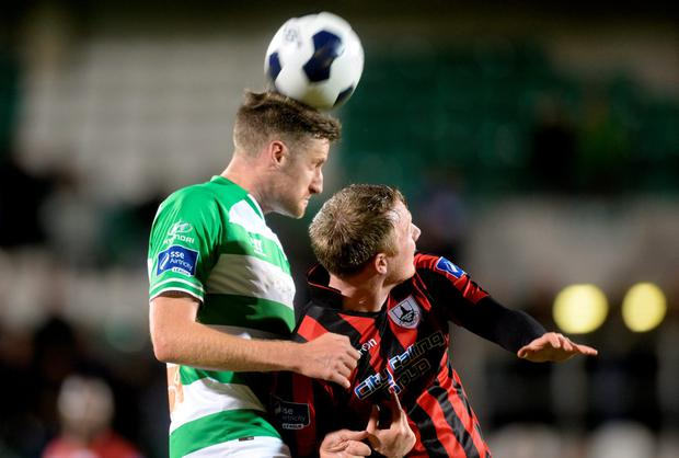 Jason McGuinness, Shamrock Rovers, in action against Petyer Hynes, Longford Town