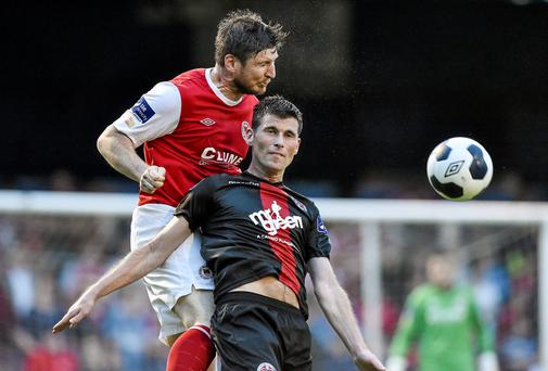 Ken Oman, St Patrick's Athletic, in action against Dinny Corcoran, Bohemians