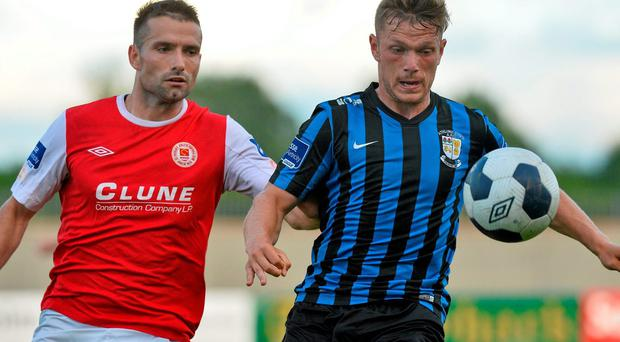 Kealan Dillon, Athlone Town, in action against Christy Fagan, St. Patricks Athletic