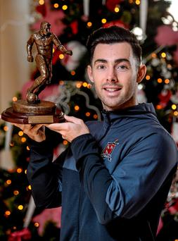 Richie Towell with his player of the month award for November