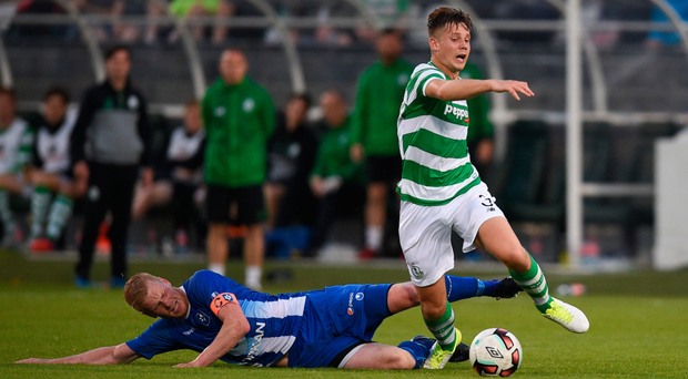 Luke Byrne tries to get away from Baldur Sigurðsson during the Europa League match in Tallaght. Photo: Sportsfile
