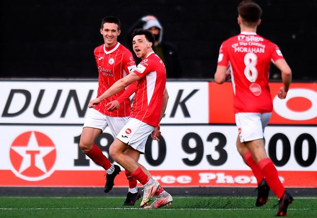 Jordan Gibson of Sligo Rovers celebrates after scoring his side's first goal with team-mate Johnny Kenny, left, during the SSE Airtricity League Premier Division match between Dundalk and Sligo Rovers at Oriel Park in Dundalk last night. Photo: Ben McShane/Sportsfile