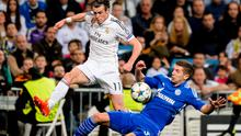 Real Madrid's Welsh forward Gareth Bale (L) vies with Schalke's Serbian defender Matija Nastasic during a UEFA Champions League match