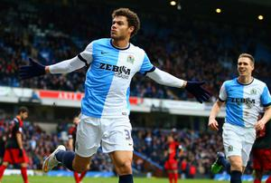 Rudy Gestede of Blackburn Rovers celebrates as he scores their second goal during the FA Cup Fourth Round match between Blackburn Rovers and Swansea City