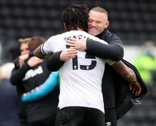 Derby County manager Wayne Rooney celebrates after the match with Colin Kazim-Richards. Action Images via Reuters/Molly Darlington