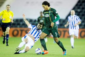 Celtic's Virgil Van Dijk (right) and Kilmarnock's Ross Barbour during the Scottish Premiership match at Rugby Park, Kilmarnock