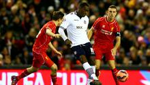 Emile Heskey of Bolton Wanderers passes the ball under pressure from Joe Allen and Jordan Henderson of Liverpool during the FA Cup Fourth Round match between Liverpool and Bolton Wanderers at Anfield
