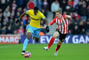 Crystal Palace's English midfielder Wilfried Zaha (L) vies with Southampton's English defender Matt Targett (R) during the FA Cup fourth round football match between Southampton and Crystal Palace at St Mary's Stadium
