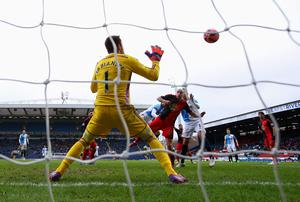 Rudy Gestede of Blackburn Rovers (obscured) scores their second goal past goalkeeper Lukasz Fabianski of Swansea City during the FA Cup Fourth Round match between Blackburn Rovers and Swansea City
