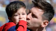Lionel Messi with his son Thiago at the Camp Nou