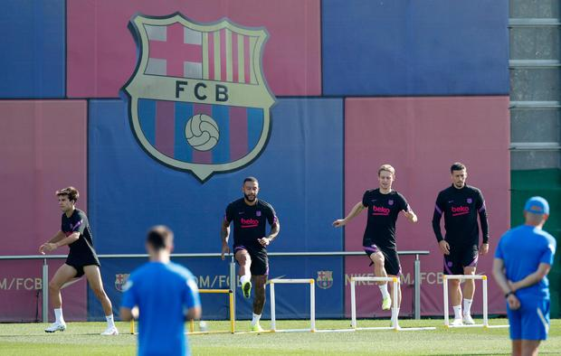 Barcelona's Riqui Puig, Memphis Depay, Luuk de Jong and Clement Lenglet during training - Barcelona's ability to recruit players has been massively hit. Photo: Reuters