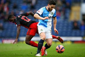 Craig Conway of Blackburn Rovers battles with Nathan Dyer of Swansea City during the FA Cup Fourth Round match between Blackburn Rovers and Swansea City
