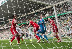 Celtic's Jason Denayer (obscured left) scores his goal during the Scottish Premiership match at Celtic Park, Glasgow