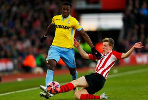 Wilfried Zaha of Crystal Palace is challenged by Matt Targett of Southampton during the FA Cup Fourth Round match between Southampton and Crystal Palace at St Mary's Stadium